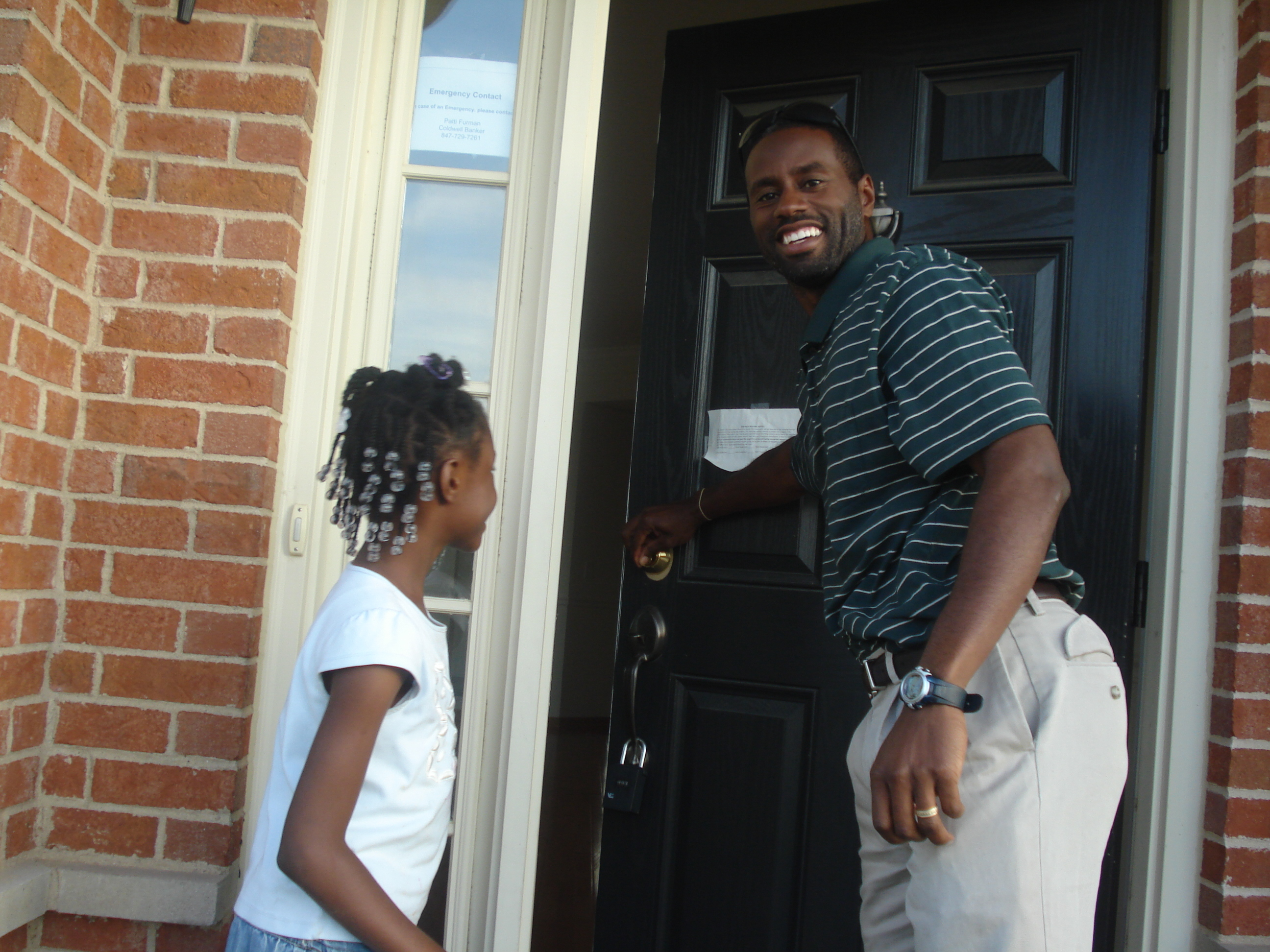 Tyrone opening the door of his new home as Naomi looks on with much joy and excitement!