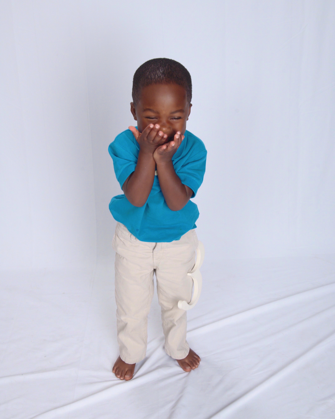 Isaiah covering face