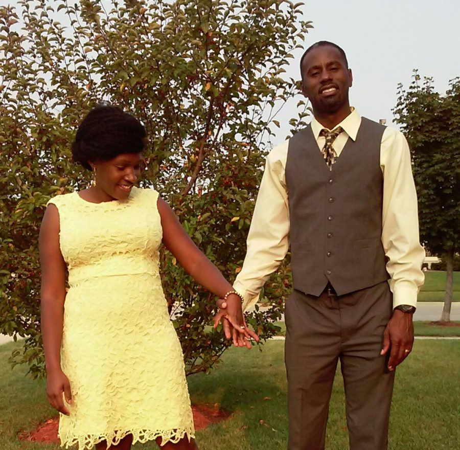 anika and tyrone holding hand in yellow